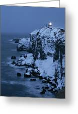 A Lighthouse Atop Snow-covered Cliffs Greeting Card