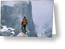 A Man Stands On A Cliff Watching Greeting Card