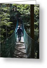 A Man Walks Across A Suspension Bridge Greeting Card by Taylor S. Kennedy