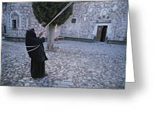 A Nun Pulls On Ropes In A Courtyard Greeting Card by Tino Soriano
