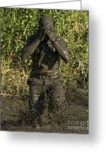 A Participant Wipes Mud From His Face Greeting Card