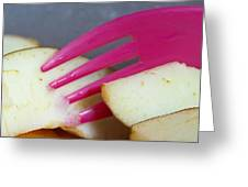 A Plastic Fork Being Used To Cut Into A Piece Of Cut Apple Pieces Greeting Card