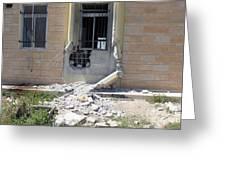 A Rocket Propelled Grenade Damaged This Greeting Card