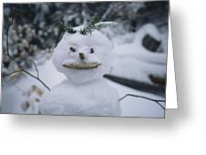 A Smiling Snowman With Twig Arms Greeting Card