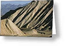 A Truck Is Dwarfed By Eroded Desert Greeting Card