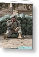 A U.s. Army Soldier Talks On A Radio Greeting Card