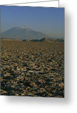 A Volcano Rises Above A Dry Lake Bed Greeting Card
