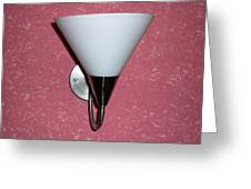 A Wall Mounted Lamp Set Against A Pink Printed Wall Color Greeting Card