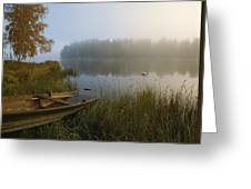 A Weathered Rowboat On The Shore Greeting Card