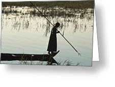 A Woman Stands At The End Of A Rowboat Greeting Card by Lynn Abercrombie