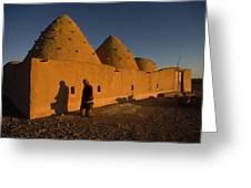 A Woman Walks Past A Sunlit Mud Brick Greeting Card