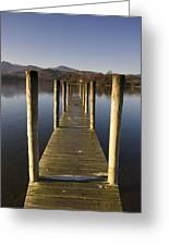 A Wooden Dock Going Into The Lake Greeting Card