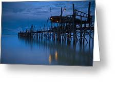 A Wooden Pier With Lights On It At Greeting Card