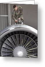Airman Checks Components Atop A C-5 Greeting Card