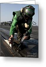 Airman Greases The Catapult Shuttle Greeting Card