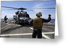 Airman Signals To An Mh-60s Sea Hawk Greeting Card