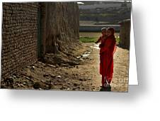 An Afghan Girl Carries Her Little Greeting Card