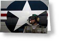 An Airman Stands In Front Of A C-2a Greeting Card