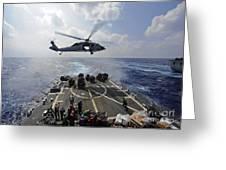 An Mh-60r Sea Hawk Transfers Supplies Greeting Card