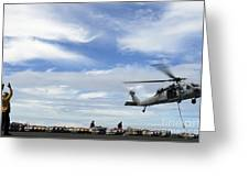 An Mh-60s Sea Hawk Lifts A Pallet Greeting Card