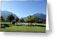 An Open Field In Interlaken With A View Of The Mountains In The Background Greeting Card