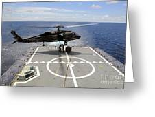 An Sh-60f Sea Hawk Helicopter Lowers Greeting Card