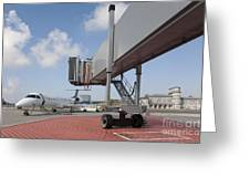 Boarding Bridge Leading To A Parked Plane Greeting Card