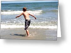 Boy Running Into Surf Greeting Card