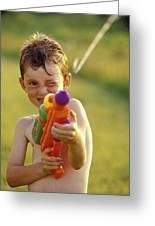 Boy Spraying Water Gun Greeting Card