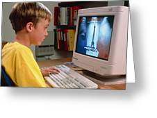 Boy Using A Multimedia Computer To Learn French Greeting Card by Damien Lovegrove