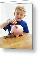 Child With A Piggy Bank Greeting Card by Ian Boddy