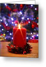 Christmas Candle With Starburst And Decorated Tree Background. Greeting Card