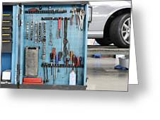 Closeup Of A Variety Of Tools On A Blue Greeting Card by Corepics
