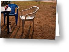 Coffee Cups Along With Chairs And Tables In A Quiet Location At Sunset Greeting Card