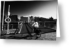 Commuter Cycling Over The Tradeston Bridge Pedestrian Bridge Over The River Clyde To The Financial D Greeting Card
