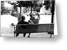 Couple Resting On A Downtown Bench On A Windy Day Greeting Card