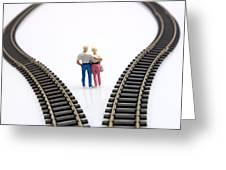 Couple Two Figurines Between Two Tracks Leading Into Different Directions Symbolic Image For Making Decisions Greeting Card