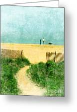 Couple Walking Dog On Beach Greeting Card by Jill Battaglia