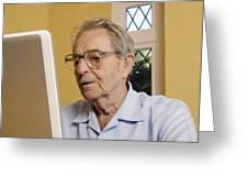 Elderly Man Using A Laptop Computer Greeting Card
