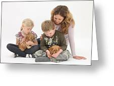 Family With Cockerpoo Pups Greeting Card