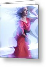 Fashion Photo Of A Woman In Shining Blue Settings Wearing A Red  Greeting Card