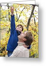 Father Carrying His Son In A Wood Greeting Card by Ian Boddy