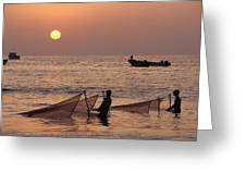 Fishermen Holding Nets In Sea At Sunset Greeting Card