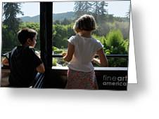 Girl And Boy Looking Out Of Train Window Greeting Card