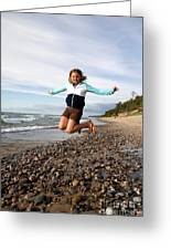Girl Jumping At Lake Superior Shore Greeting Card