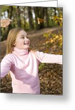 Girl Playing With Autumn Leaves Greeting Card