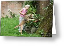 Girl Playing With Dog Greeting Card