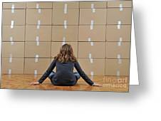 Girl Seated In Front Of Cardboard Boxes Greeting Card