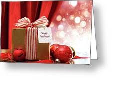 Gold Christmas Gift Box And Ornaments With Sparkle Lights  Greeting Card