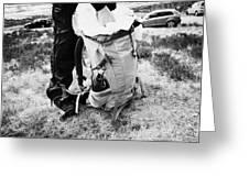 hiker hillwalker packing rucksack before going hiking in the highlands of Scotland UK Greeting Card